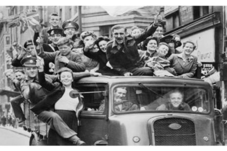 A truck of revellers passing through the Strand, London [Picture: Imperial War Museum HU 41808]