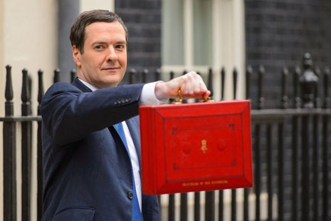 Chancellor, George Osborne holding up the Budget box