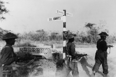 Indian infantrymen of IV Corps advancing towards the vital road and rail junction of Meiktila, south of Mandalay in the Irrawaddy Valley (Copyright NAM)