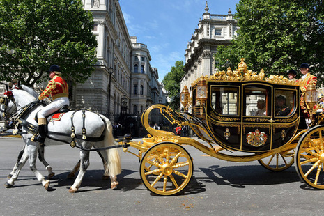 HM Queen in her carriage travelling down Whitehall to Parliament to deliver her speech.