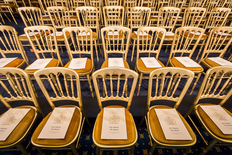 Chairs at the Houses of Parliament with copies of the Queen's Speech on them.