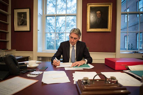 Chancellor writing his speech at his desk
