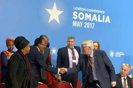 Somalian President shaking hands with an attendee of the London Somalia Conference 2017