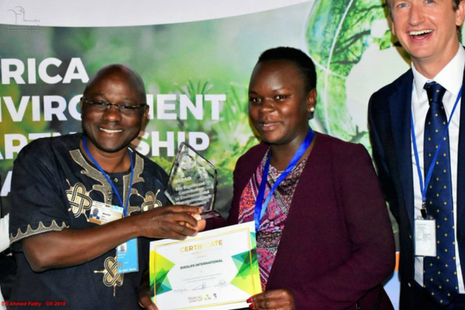 Ken Mwathe, Programme Manager at BirdLife International, receiving an award.