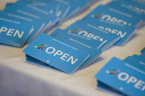 Agendas for the Open Government Partnership Summit 2013 on a table