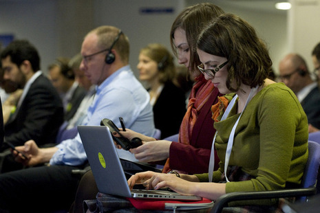 Open Government Partnership 2013 attendees using their laptops.