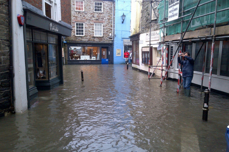 Flooded road and shops in Albert Quays, Fowey.