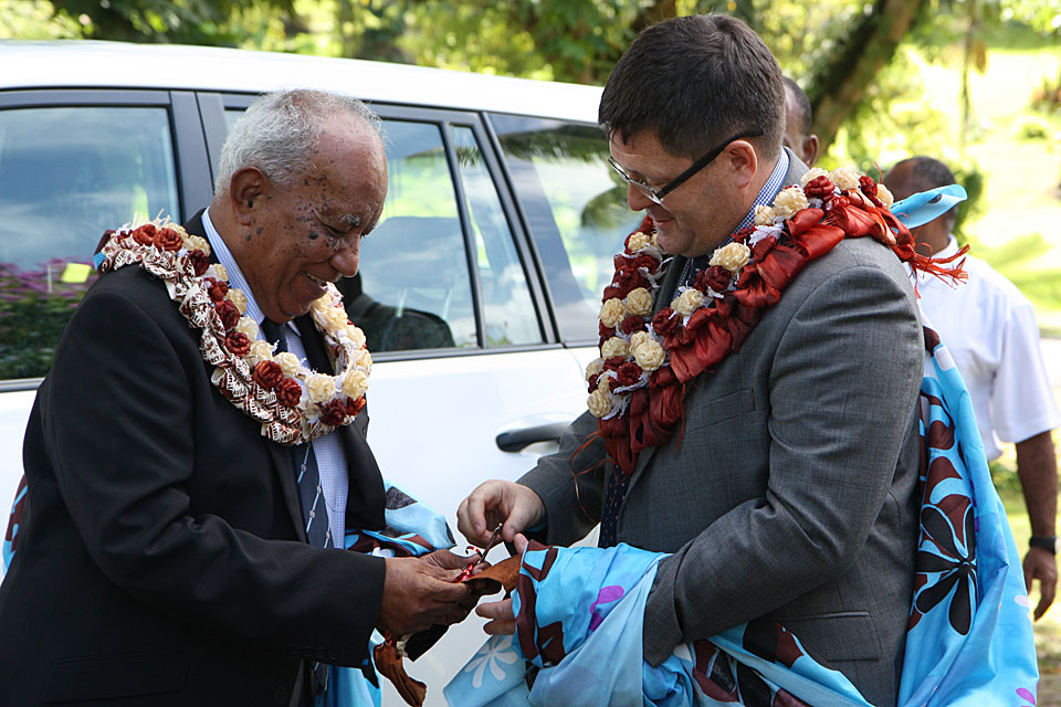 Fiji's Minister for Defence Hon Jonetani Cokanasiga hands over the keys to the welfare centre to the High Commissioner His Excellency Roderick Drummond.
