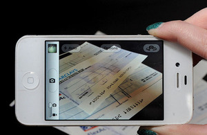Mobile phone capturing a picture of a cheque