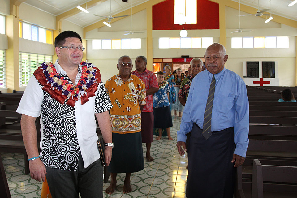 High Commissioner His Excellency Roderick Drummond with village elders.