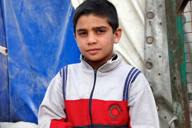 A young Syrian boy now living in an informal settlement in Lebanon's Bekaa Valley, close to the border with his home country. Picture: Russell Watkins/DFID