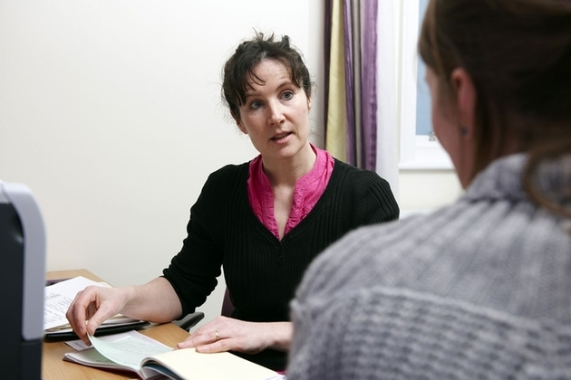 A female GP talking to a patient