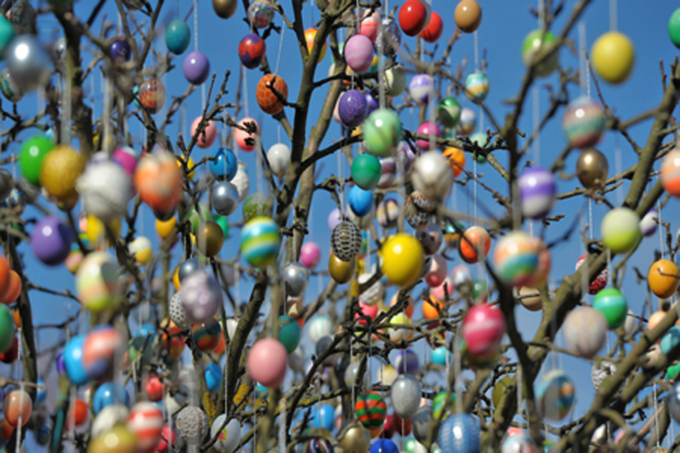 Painted Easter eggs hanging from a tree