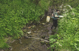 Environment officer collecting evidence of the impact of the pollution