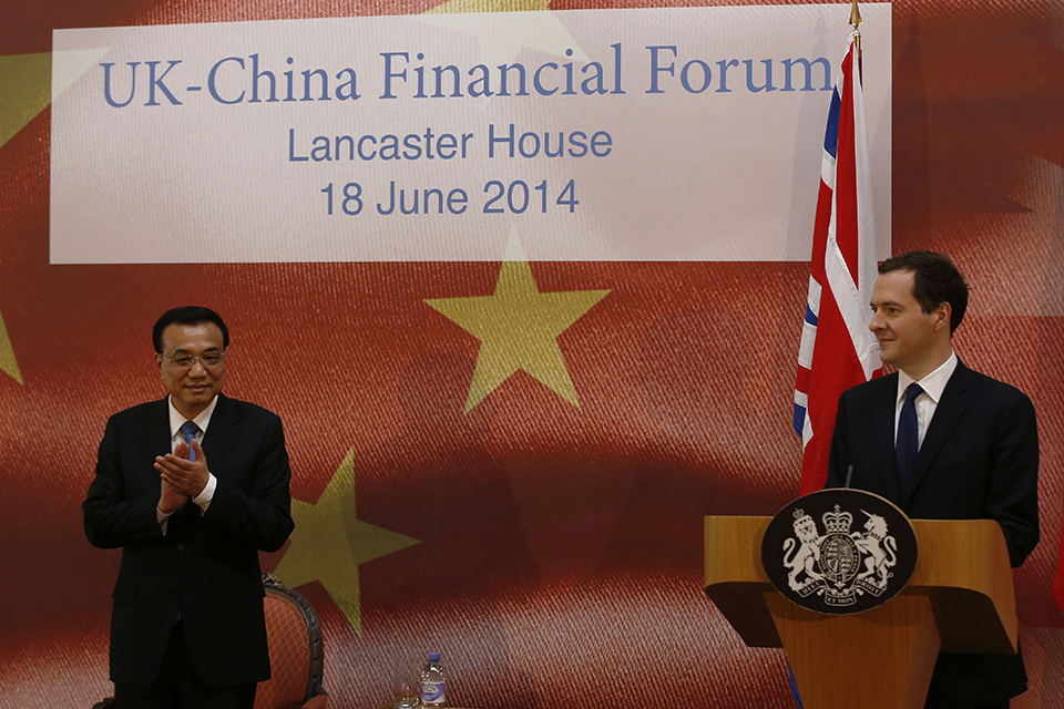 Chinese premier Li Keqiang (left) applauds as Chancellor George Osborne prepares to address the delegates of the UK-China Financial Forum at Lancaster House, in London.