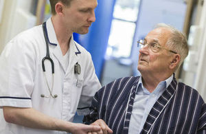 A healthcare professional in conversation with a patient