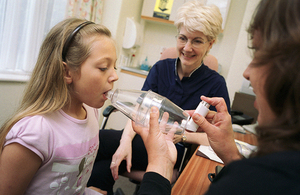 Child learning how to use an asthma inhaler