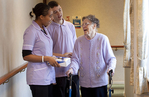 Older woman with carers