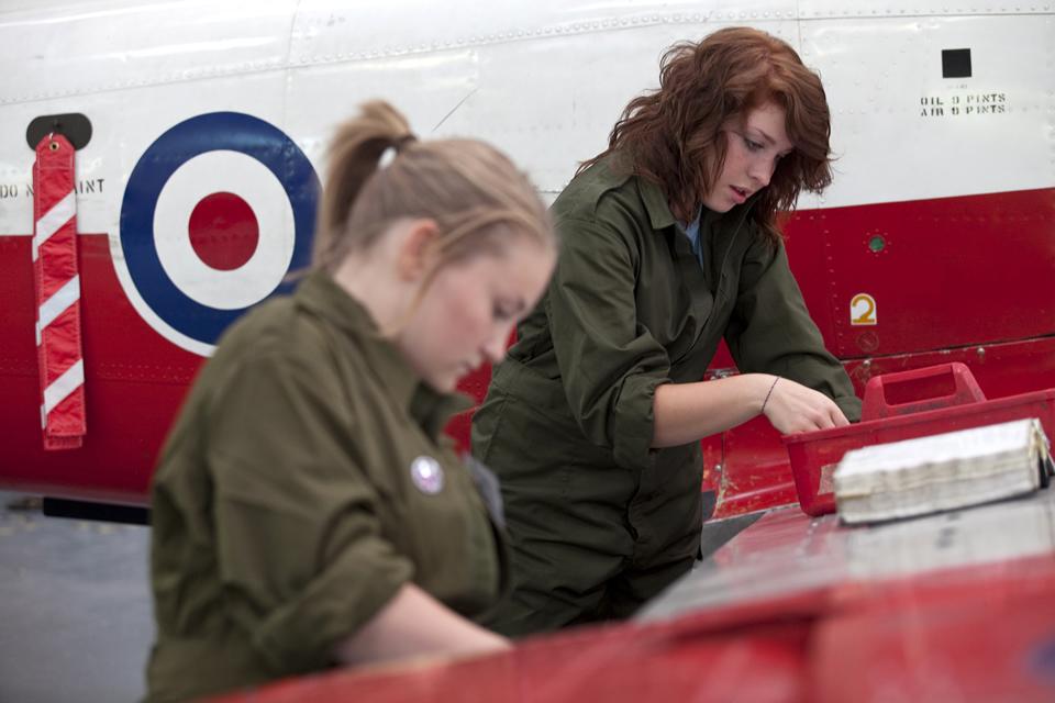 young women repairing an aeroplane