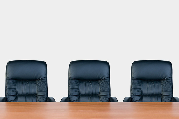 Image of three chairs behind a desk - image licensed by Ingram image
