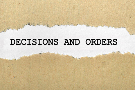 decisions and order text within ripped paper - licensed from Ingram image