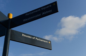 Pavement signpost showing Parliament Square, Westminster Abbey and Houses of Parliament.