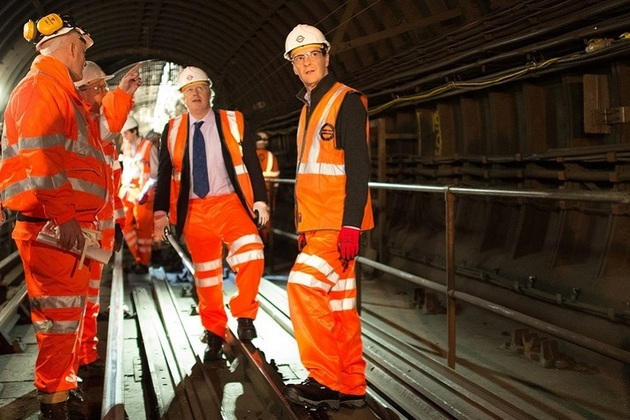 Chancellor of the Exchequer George Osborne and Mayor of London Boris Johnson meet London Underground workers in one of the tunnels on the Victoria Line. Licensed from PA Images.