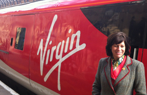 Clare Perry with Virgin train.