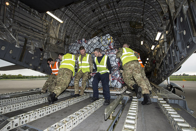 Movers loading aid for Nepal onto RAF C17