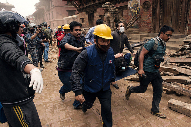 Emergency workers rescue a victim of the Nepal earthquake. Picture: Carl Whethan/IFRC