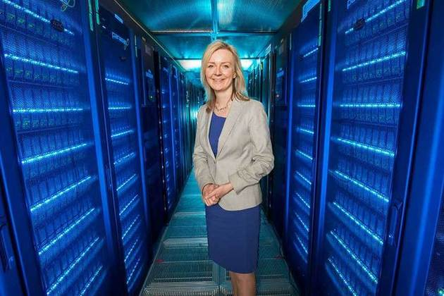 Environment Secretary standing in data storage area