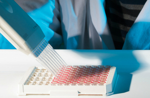 A scientist carries out analysis in the laboratory