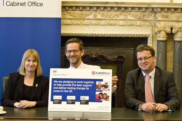 Helena Herklots, Richard Heaton and Rob Wilson with the Cabinet Office pledge.