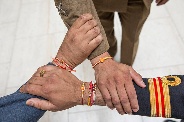 Rakhis are tied on the wrists of Armed Forces personnel