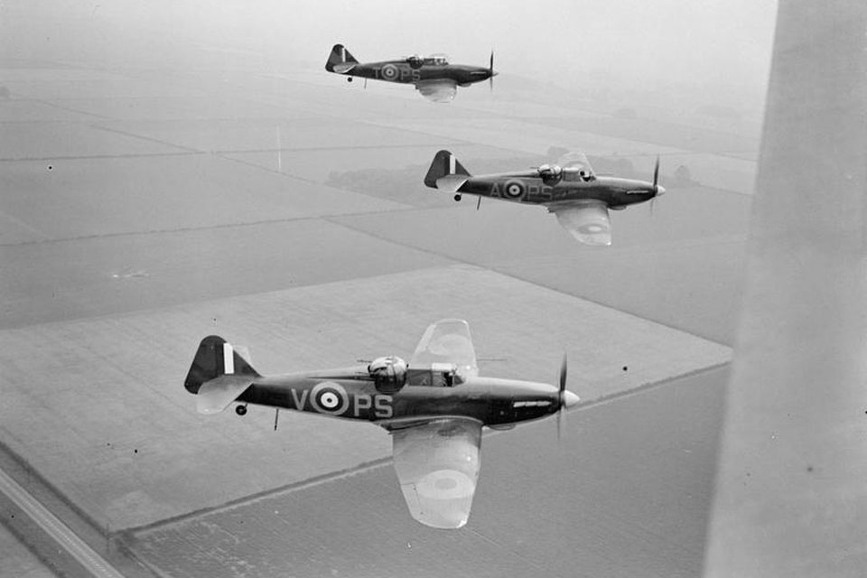 Three Boulton Paul Defiants of No. 264 Squadron fly in a 'vic' formation, August 1940. © IWM (CH 885)