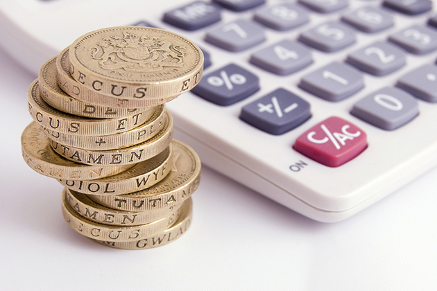 Pile of pound coins by calculator (Copyright: istock)