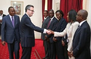 British High Commissioner, Nic Hailey, meets Kenyan Ministry of Foreign Affairs officials while President Kenyatta looks on