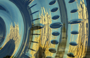 Cambridge University reflected in the golden face of the 'Chronophage' clock (credit: Tanya Hart/CC BY-SA 2.0)