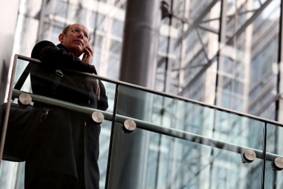 Businessman speaking on mobile phone. Photo by Getty Images