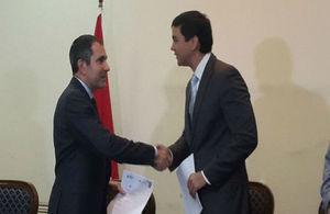 Ambassador Hobbs and Santiago Peña sign the agreement