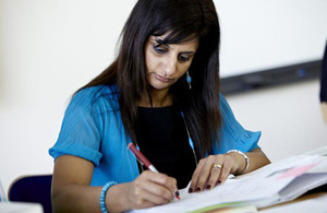 Lady completing paper work