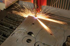 Machine tool cutting metal (Shutterstock)