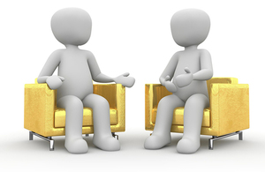 two animated cartoon people sitting in yellow chairs
