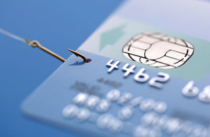 Credit card with fishing hook - phishing
