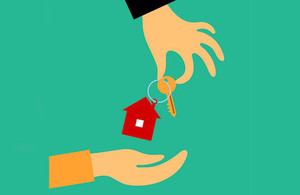 Hands with a house keyring copyright istock/LinorR