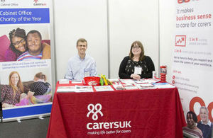 Photo of staff manning the Carers UK stand at Civil Service Live 2015: London