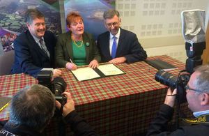 Andrew Dunlop signing Inverness UK City Deal
