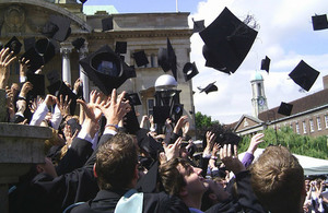 Graduates throwing their mortar boards in the air (credit: David Morris/CC BY-SA 2.0)