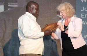 HE Alison Blackburne presents award to Moses Omoding