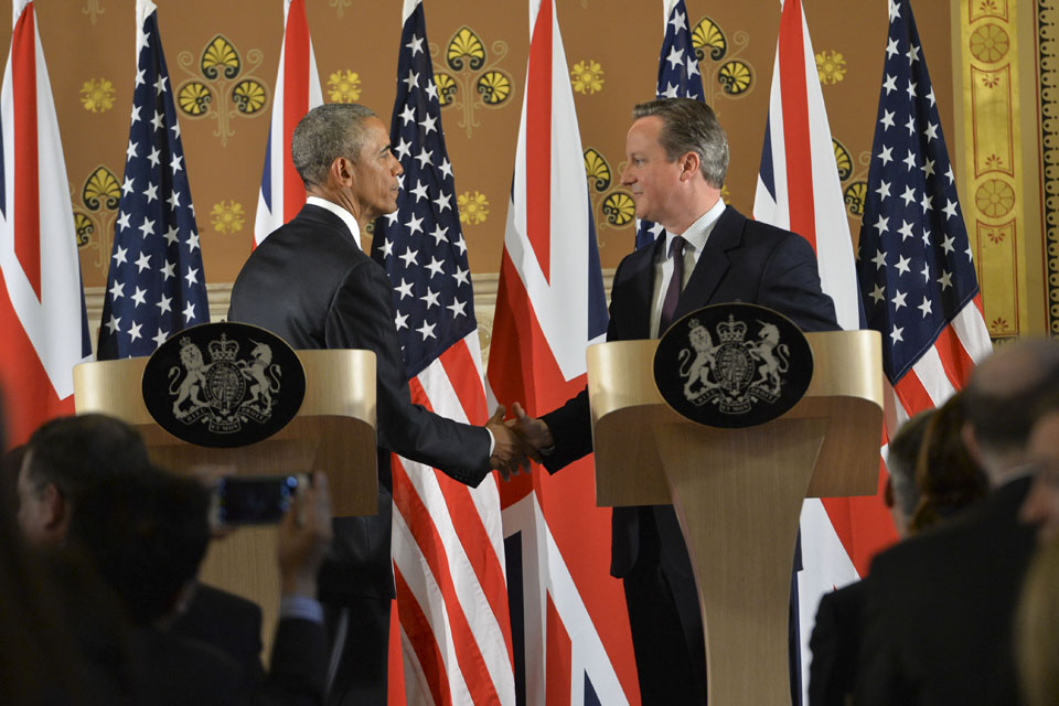 Prime Minister David Cameron shaking hands with President Obama at their joint press conference.